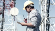 HD DOLLY : Engineer working at telecommunication tower site