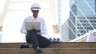 Engineer working with Laptop outdoor