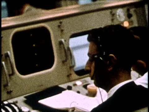 NASA engineers at work at Mission Control Center and view of / Houston Texas United States