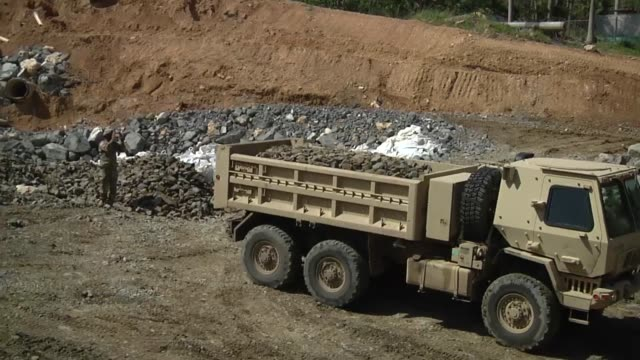Engineers from the 130th and 190th Engineer Battalions of the 101st Troop Command work at the Guajataca Dam This work is alongside the local Water...