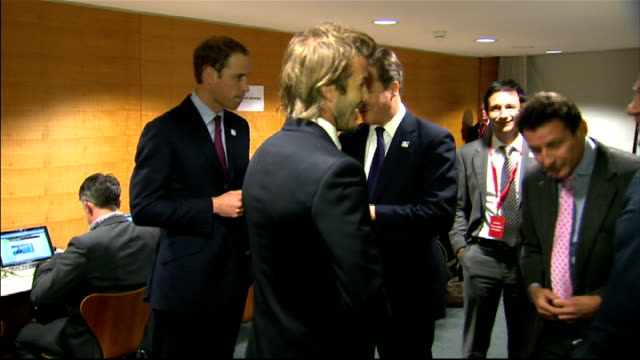 David Cameron Prince William David Beckham and others chatting SWITZERLAND Zurich PHOTOGRAPHY** Various of England bid team members chatting...