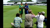 Captains' pose with trophy 1172003 ENGLAND London Lords Cricket Ground EXT England cricketers Graeme Smith and Michael Vaughan pose on pitch with one...