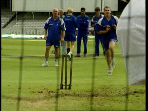 Cricketer bowling in nets PAN CBV 'Surrey county cricket club' sweatshirt GV Cricketer bowling ball towards batter in nets MS Bowler along throws...