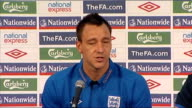 England John Terry press conference SOUTH AFRICA Rustenburg INT Wide shot John Terry arriving into room for presser John Terry press conference SOT...
