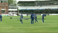 England practice session at Lords More of team warming up / players practising catching / practising in nets / bowlers / more net practice