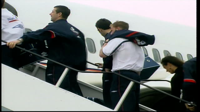 England team boarding plane for flight to Albania ENGLAND Liverpool Airport EXT Coach along / Sven Goran Eriksson off team bus then along with...