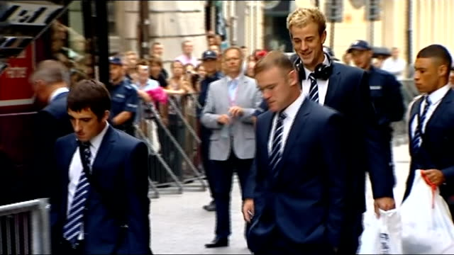 England team leave hotel following quarter final defeat POLAND Krakow EXT England players from hotel and onto coach including close shots of Wayne...