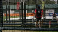 England training ahead of first test against India 'Lord's The Home of Cricket' sign / more shots of England cricketers training batting and bowling...