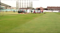 London The Oval EXT England cricketers on pitch including Kevin Pietersen Steve Harmison England coaching staff on pitch including Peter Moores and...