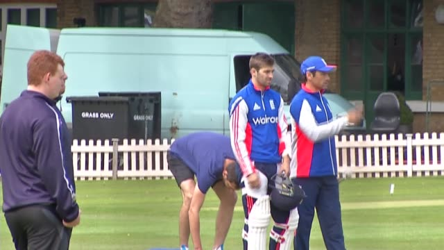 England players train in nets Ground as rain falls / England players standing chatting and along at ground in rain / Steve Finn practicing bowling in...