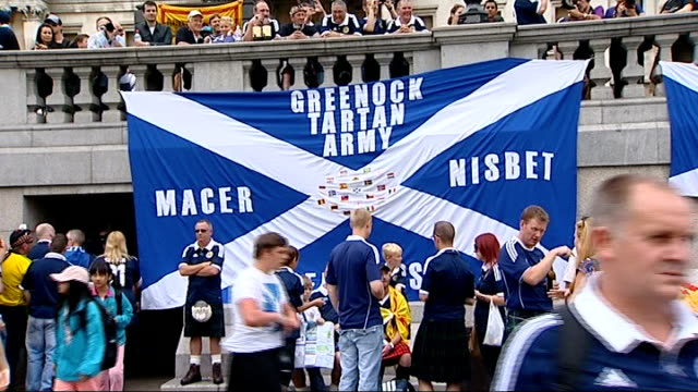 London Trafalgar Square EXT Scottish football fans celebrating with wine and beer by Nelson's Column Greenock Tartan Army Macer Nisbet' on Scottish...