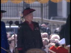 Whitehall 0240 EXT The Queen accompanied by Officer walking past soldiers
