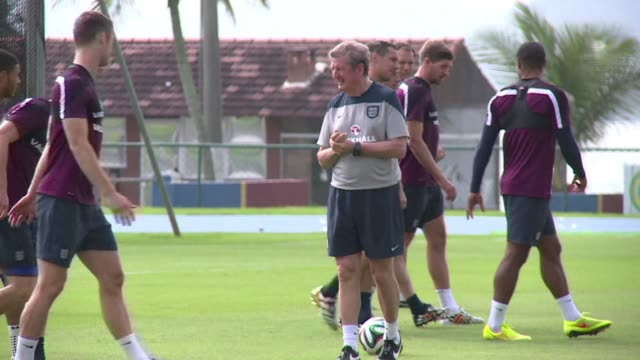 Englands disconsolate players made their first public appearance since being eliminated from the World Cup in a subdued training session at their Rio...