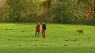 Englischer Garten, autumn,  lawn, trees, an old couple with dog