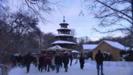 Englischer Garten - Chinesischer Turm, christmas market, snow, walking people, Biergarten