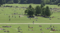 Englischer Garten,  lawn, trees,  blue sky, people, from above, frisbee
