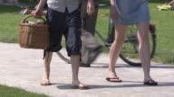 Englischer Garten, summer,  sunny, park, a couple walking through the park, legs