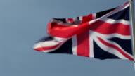 CU, English flag blowing in wind, France