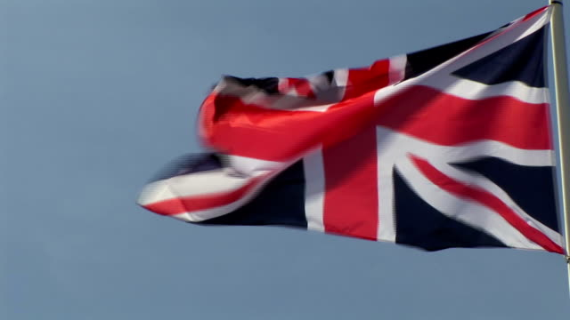 CU, English flag blowing in wind, France