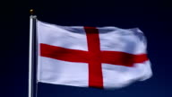 4K: English Flag on Flagpole in front of Blue Sky outdoors (England)