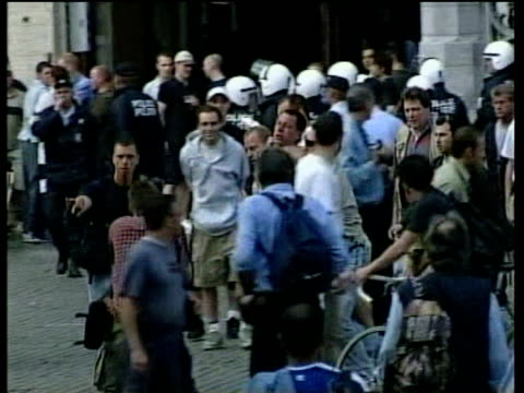 English football supporter is restrained by neck and escorted across town square by Belgian police during European Cup finals Charleroi 16 Jun 00