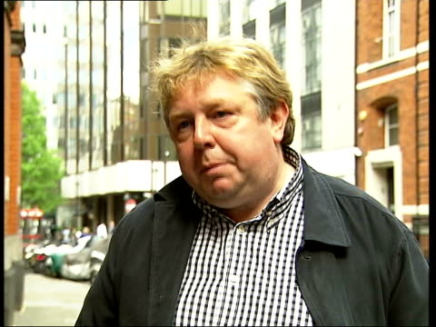 'Darling' ban ITN ENGLAND London EXT Nick Ferrari using words such as sweetheart darling etc SOT Man leaning over woman working at desk Nick Ferrari...