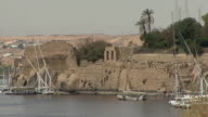 POV Entering harbor of Aswan with feluccas docked at Elephantine Island, Aswan, Egypt