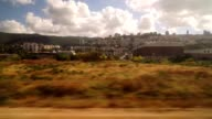 Entering the city of Haifa by train on a cloudy spring day