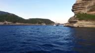 Enterning Bonifacio harbor in the Mediterranean sea in Corsica, France