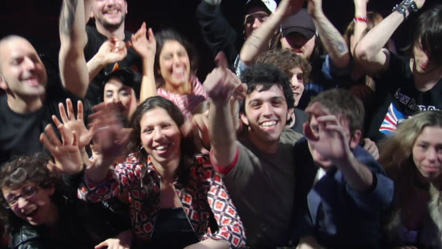 MS ZI ZO Enthusiastic fans cheer at a rock & roll concert / Buenos Aires,  Argentina