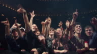 WS PAN Enthusiastic fans cheer & reach for performer's discarded clothing at a rock & roll concert / Buenos Aires,  Argentina