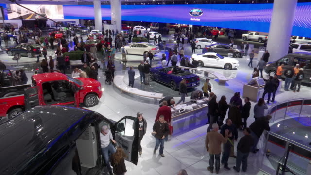 ACROSS entire Ford exhibit from second floor POV / WS time lapse looking down on exhibit from 2nd floor POV