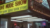Entrance to video store. see people standing under awning near entrance.