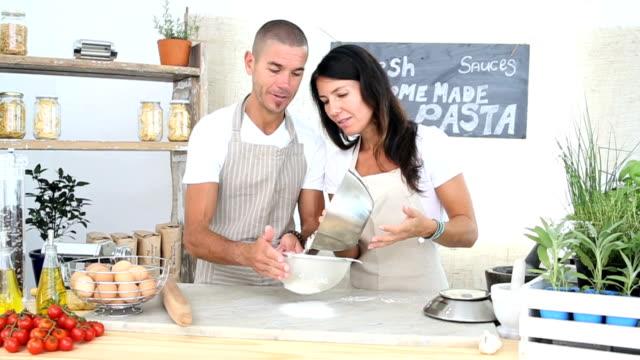 Entrepreneurs Sifting flour at the organic market stall