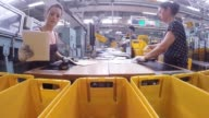 Envelopes sit in crates as they move along a mail sorting machine conveyor inside a Deutsche Post AG postal sorting office in Frankfurt Germany on...