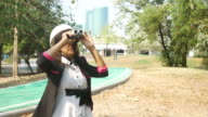 environment engineer using binocular to survey around construction site