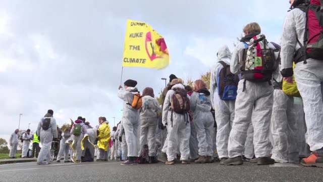 Environmental activists wearing hazard suits march onto one of the world's largest openpit coal mines near Bonn on the eve of 196 nation UN climate...