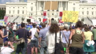 Environmentalists Hold Signs While Watching Speech at US Capitol on July 28 2012 in Washington DC