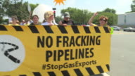 Environmentalists march hold signs and chant against the Cove Point liquefied natural gas facility