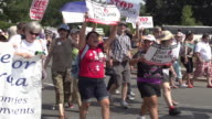Environmentalists March in Slow Motion at Rally Against Fracking at the US Capitol on July 28 2012 in Washington DC