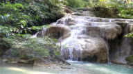 HD: Erawan waterfall flowing down the mountain through the rocks.