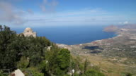 Erice, view of the San Giovanni Battista church, and the valley and coast of the Mediterranean sea