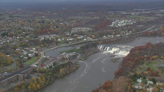 AERIAL Erie canal next to Cohoes Falls on the Mohawk River / Waterford, New York, United States