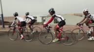 Eritrean cyclist Daniel Teklay is back on his bike in Ethiopia where he is the top performer on a team of Eritrean refugees who have posted...