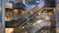 Escalator 4k shopping mall crowd of people buy shop center centre