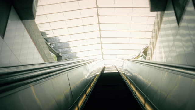 Escalator Going Up into Sunlight