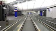 escalator in airport, shot in asia
