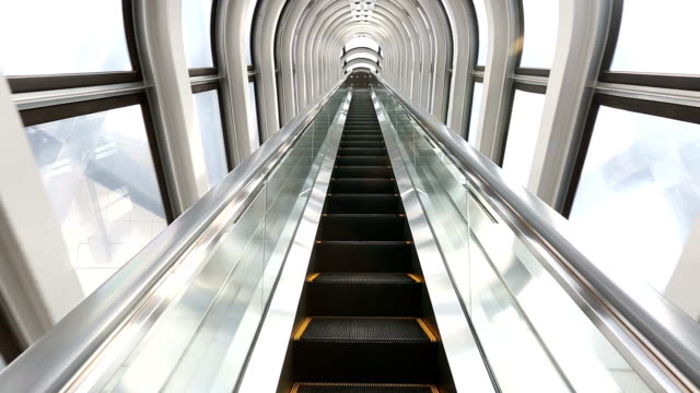 HD: Escalator moving up in Modern Building