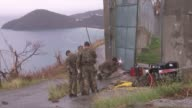 Escaped prisoners give up or are recaptured Various of Royal Marines working to repair prison gates Royal Marine standing guard