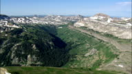 Escarpment Running Past Fossil Mountain  - Aerial View - Wyoming,  Teton County,  helicopter filming,  aerial video,  cineflex,  establishing shot,  United States